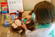 Set up a Pretend Play Vet's Office for kids. They will have so much fun taking care of animals. Get a free printable for the vet's office. Animal Activities, Indoor Activities For Kids, Toddler Activities, People Who Help Us, Vet Office, Dramatic Play Area, Pet Vet, Pet Clinic, Daycare Crafts