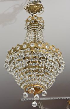 Hollywood Regency, Louis XVI Style Chandelier in Antique Brass and Crystals 7