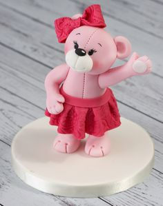 Pink fondant icing bear with embossed skirt #embossing #pinkicing #teddybear