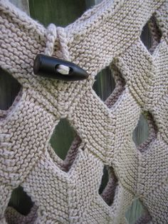 """Pattern Description from Interweave Knits, Spring 2009: """"Vivian Høxbro's Net Duffle Bag has a sturdy mesh-like texture formed by joining incomplete mitered squares. A strong linen yarn holds yarn, produce, books, or anything else you can imagine firmly without sagging."""""""