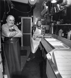 Ansel Adams and his assistant Alan Ross in his darkroom.