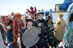 Earth Celebrations Hudson River Pageant, New York City. Trash Tricksters taunting the river species. Photo by Christopher Butt.