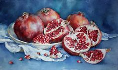 Still life with pomegranates on a blue background