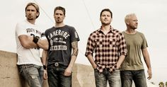 Nickelback...I love their tunes and would love to see them live {someday}.