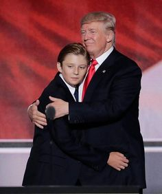 Barron Trump and his father- These are people as much as you try to dehumanize this family.