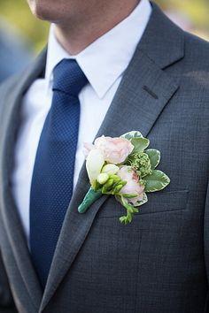 Blush pink ranunculus and white freesia boutonniere