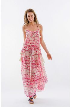 1a12f335190d Pink printed sleeveless maxi dress with a scoop neckline, string straps and  tassel tie details. Shoptiques