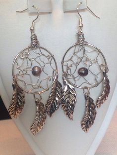 A personal favorite from my Etsy shop https://www.etsy.com/listing/246037093/pearl-dreamcatcher-dangle-earrings