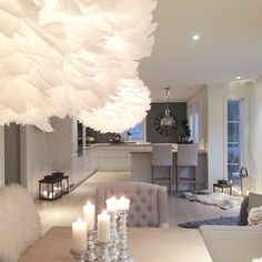 Gray, silver, white, black, faux fur, lanterns, cable knit throw, sheep skin, large clock, unique lights, chic, simple, non-cluttered