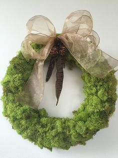 "Moss wreath with pheasant feathers, small pine cones and soft gold shimmer ribbon. 13"" diameter Made to order."