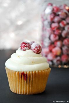 Cranberry Orange Cupcakes topped with candied cranberries  |  by Carrie Sellman