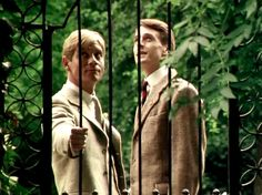 Lord Sebastian closes the gate as he and Charles enter the garden, at Brideshead.