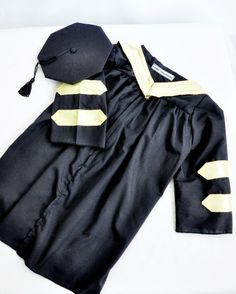 baby Cap and gown. This is for a doctoral Graduation. Love that my infant can be in a cap and gown and graduate with us!