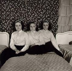 3 on a match  Triplets in their bedroom, 1963 © Diane Arbus