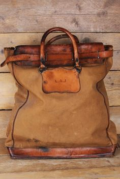 purse, leather and canvas?  love the worn look