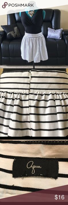 """❤️ Black and white striped mini skirt  Black and white striped mini skirt by Aqua for Bloomingdales.  Great piece for summer!  Has 2 small pockets, one on each side. Pair it with a cute cherry  red midi top, black top bra, or a business blouse for work. Skirt is in great condition. Measures 17"""" from waistline to bottom. Aqua Skirts Mini"""