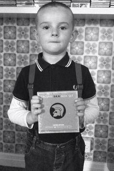 little skinhead boy with his ska record Dr. Martens, Ska Music, Skinhead Reggae, Ska Punk, Skinhead Fashion, Punk Baby, Skin Head, Teddy Boys, Rude Boy
