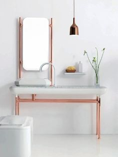 Koper en marmer in de badkamer - Inspiratie! De comeback van koper   ELLE Decoration NL