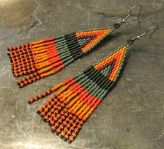 Long  Native American Style Seed Bead Earrings in orange and green tones (drab olive and avocado tones). $16.00, via Etsy.