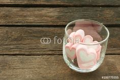 """Download the royalty-free photo """"The lovely pink heart marshmallows in round glass on old deep brown planks for Valentine's day."""" created by phasuthorn at the lowest price on Fotolia.com. Browse our cheap image bank online to find the perfect stock photo for your marketing projects!"""