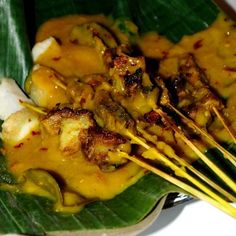 Satay Padang - Sate Padang is a speciality satay from Padang, West Sumatra, Indonesia, made from beef cut into small dices with spicy sauce on top of it. Its main characteristic is a yellow sauce made from rice flour mixed with spicy offal broth, turmeric, ginger, garlic, coriander, galangal root, cumin, curry powder and salt. In Medan, a lot of Sate Padang use not only beef but also chicken and lamb.