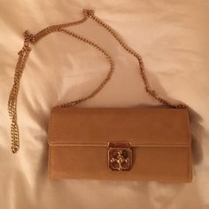 Charming Charlie's Small Camel Clutch Purse This classic camel purse is perfect for a night out to bring just the necessities. It has cute gold hardware and a gold chain strap. I've only used this purse once. It's in perfect condition. Charming Charlie Bags Shoulder Bags