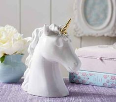 This pretty large and pretty magical unicorn head will encourage you to save for your own real life magical unicorn.