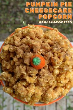 It's the season of pumpkin! This homemade Pumpkin Pie Cheesecake Popcorn recipe will put you in the Fall spirit. Full of delicious pumpkin flavor, this popcorn treat is easy to make and perfect for any occasion. Homemade Pumpkin Pie, Pumpkin Pie Spice, Pumpkin Recipes, Homemade Popcorn Recipes, Pumpkin Pie Cheesecake, Almond Bark, Savory Snacks, Chocolate Hazelnut, Yummy Food