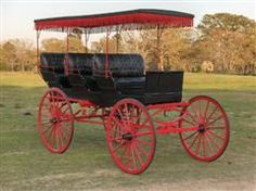 Vintage Surrey, red wheels and fringe, circa 1900s, restored (Chicks and ducks and geese better scurry, When I take you out in the Surrey, When I take you out in the surrey with the fringe on top! - Oklahoma the musical)