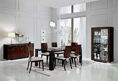 Stromboli - Alf Group Italian Modern Dining Table with 6 Chairs: Made in Italy, this gorgeous dining room set is crafted from wood with 7 layers of lacquer for durability and scratch resistance. The elegant set includes the extendable dining table and six chairs with matching buffet and mirror available.