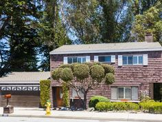 This 2-story, 3-bedroom, 2.5-bath home on Santa Cruz's West Side is surrounded by greenery from the tall trees growing in the canyon behind it, which provide both shade and privacy...(continued on website)