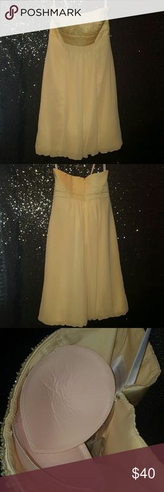 David's Bridal strapless yellow bridesmaid's dress David's Bridal strapless light yellow bridesmaids dress. Worn once. Size 2. Extra padding sewn into chest area. One slight snag on the back. David's Bridal Dresses Wedding