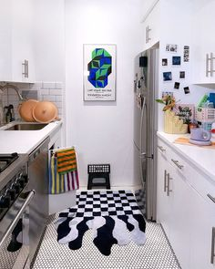 graphic runner rug kitchen Nyc Studio Apartments, Rug Over Carpet, Hotel Interiors, Smart Storage, Two Tone Cabinets, One Bedroom, Rugs In Living Room, Cool Rugs, Interior Design Kitchen