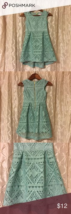 Xhilaration blue lace dress 6/6x Gently used Xhilaration dress in girls' size 6/6x. Pretty sea foam blue color with lace overlay. Has scoop neck & cute cap sleeves. Gold zipper goes up the back. Fit & flare style. Adorable! 💚20%off discount on bundles 💚offers 🚫PayPal 🚫trades Xhilaration Dresses