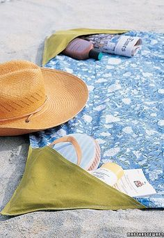 DIY ● Tutorial ● Beach Towel with Pockets... would be so cool with a zipper to put sand in to keep the corners from blowing up!  love it!  May be a way to add  side pockets to neat sheet.