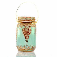 Custom Designed Aqua Glass Mason Jar Lantern with Copper Detailing. $24.00, via Etsy.