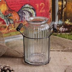 "Antique Style Blossom Vase by Designs Combined Inc.. $16.00. Features a glass vase and a metal holder.. An antique inspired blossom vase is a pretty look for any tabletop or windowsill. 7.5""H.. An antique inspired blossom vase is a pretty look for any tabletop or windowsill. Features a glass vase and a metal holder. 7.5""H."