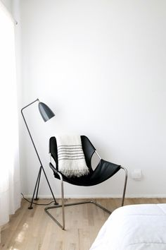 paulistano leather sling chair and grasshopper lamp