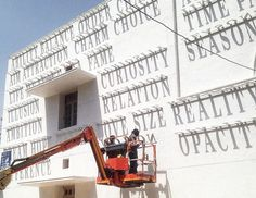 DAKU's typographic sundial in india generates ever-changing graffiti
