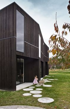 Clad in black-stained cedar, a monolithic family home rises from its alpine setting outside Queenstown, New Zealand.