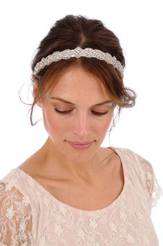 Headband Collection - 15 inches of beautiful clear rhinestone and silver beading is attached to a luxurious double-faced satin ribbon in the color of your choice.    15 inches of beading   .75 inch wide   20 inch Satin Ties    PLEASE NOTE RIBBON COLOR AT CHECKOUT   White, Light Ivory, Cream, Black, ...    $58