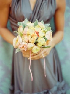 Soft pink amd yellow bridesmaid bouquet with ranunculus