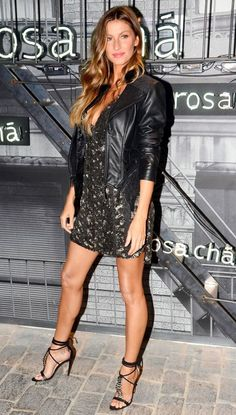 Gisele Bundchen in a printed mini dress and leather jacket