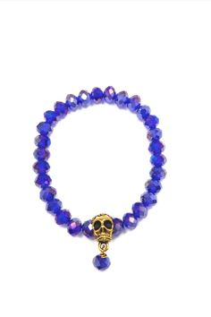 """This elasticated bracelet looks great layered with other arm candy. Fits wrist size up to 7""""  Gold Skull Bracelet by The Story Of Love. Accessories - Jewelry - Bracelets Toronto Canada"""