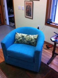 the first of two - reupholstered chair's