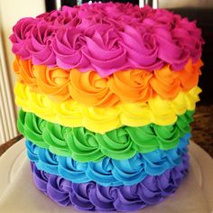 Rainbow cake #2.  Stunning inside and out.  Moist almond colorful cake with buttercream icing.