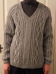 Cabled pullover for men, women, and children. Can be knit with a ribbed V neck, ribbed crew neck, or crew neck with rolled edge.