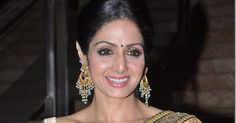 South Indian actress and Bollywood actress Sridevi  with designer chandelier earrings  and gold bangles.