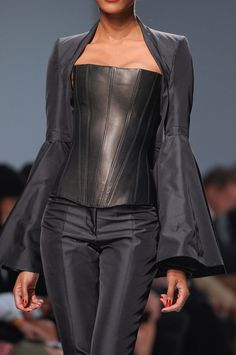 Gareth Pugh -  great suit, I'd like the corset if it were flattering to the female form, but this just flattens her out.