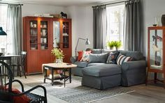 Traditionally furnished living room with HEMNES cabinet with paneled / vitrined doors in red brown